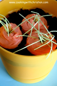 "Dirt Cake with ""Carrot Cupcakes"" topped with edible Easter grass"